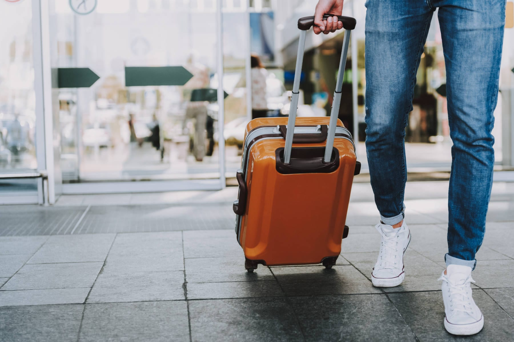 Male is carrying luggage in hall before trip