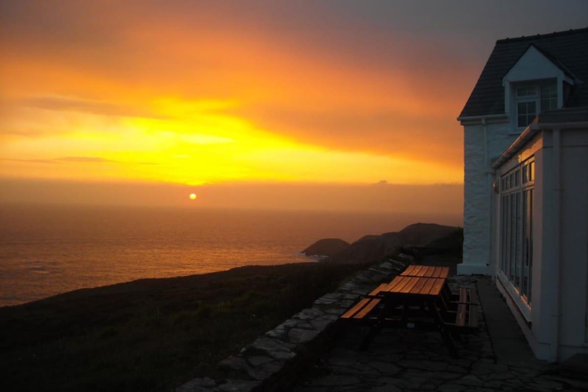 Hut overlooking the sea at sunset