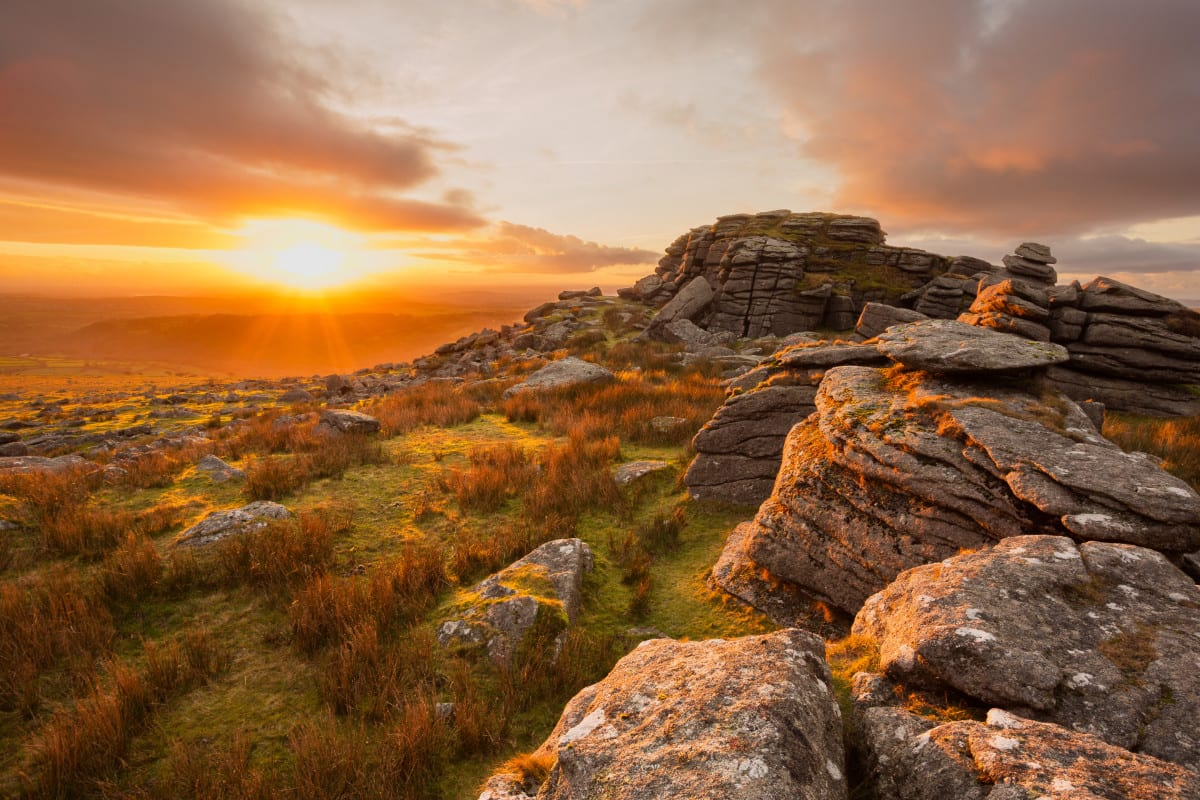 Stones on a hill at sunset
