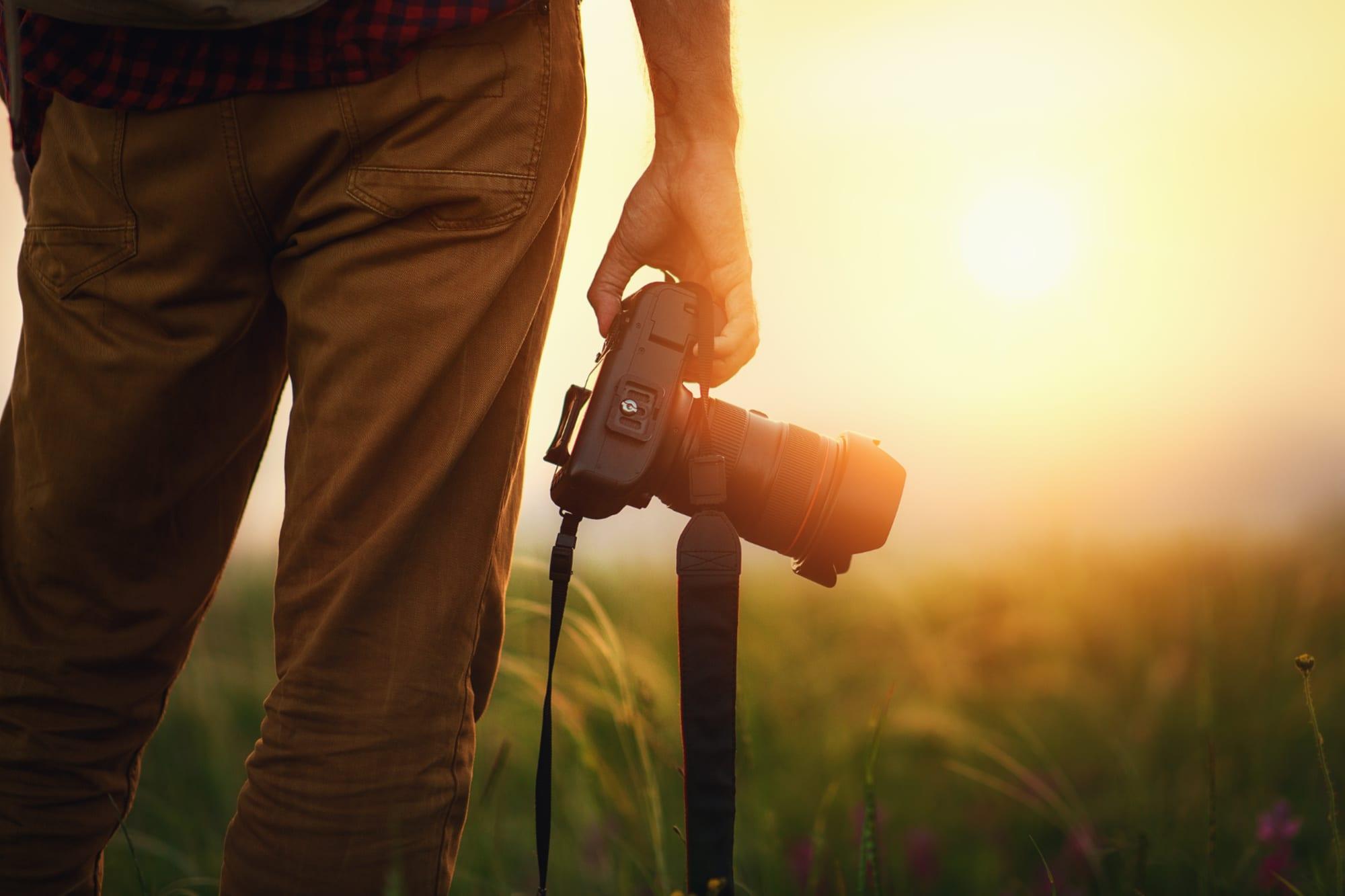 Travel photographer holding a camera
