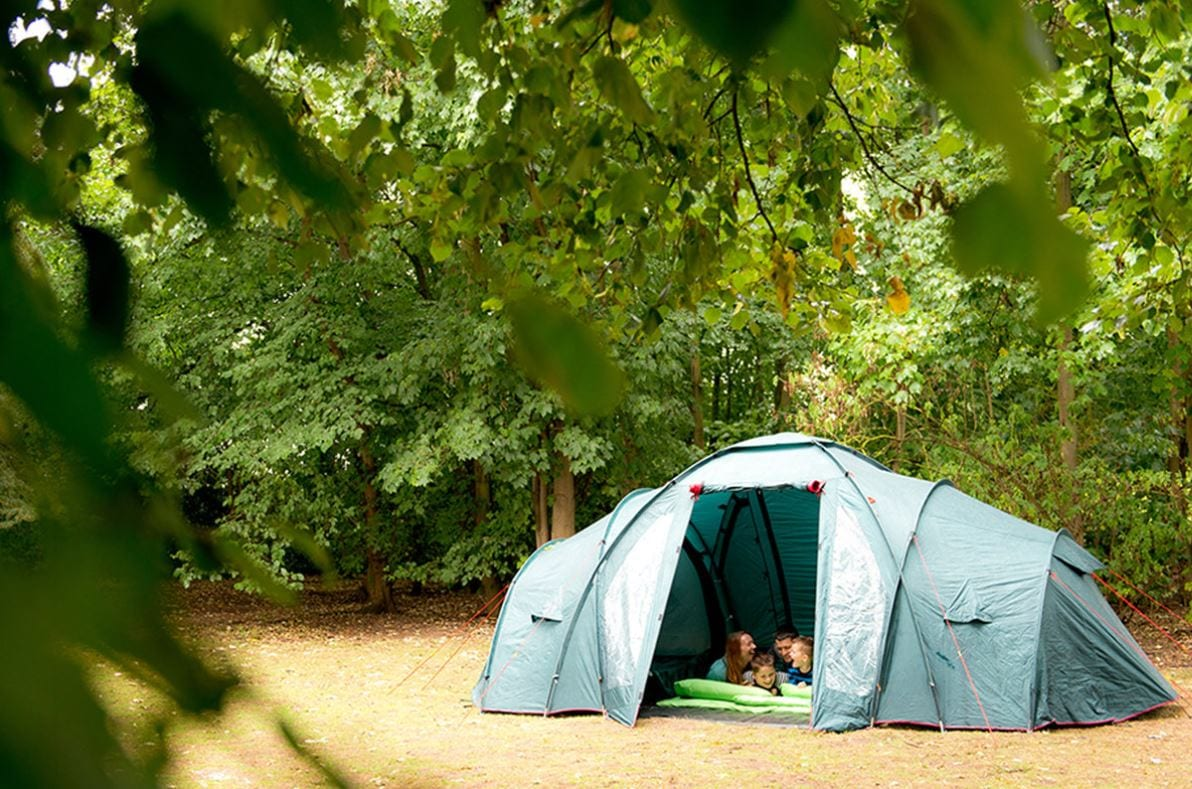 Family camping in tent