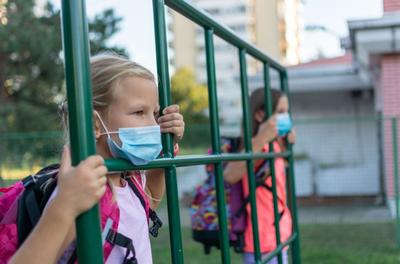 Children at school gates with mask on