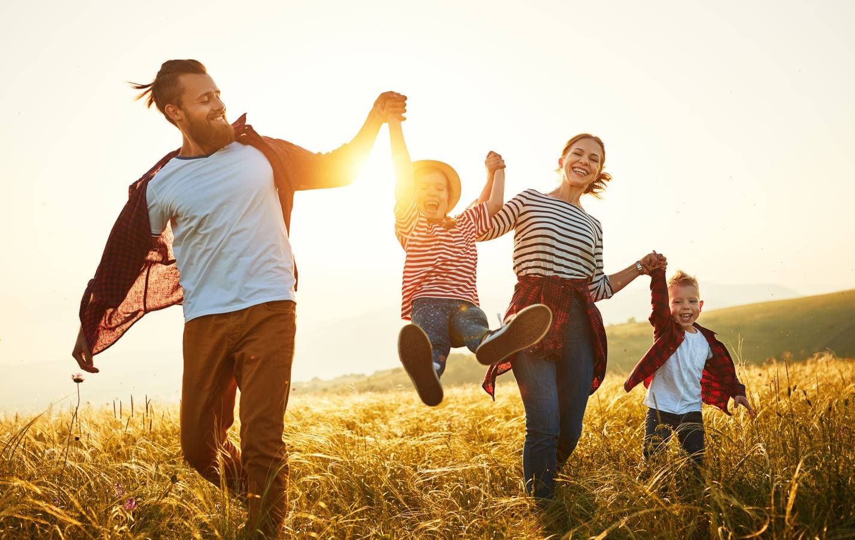 Family having fun in field