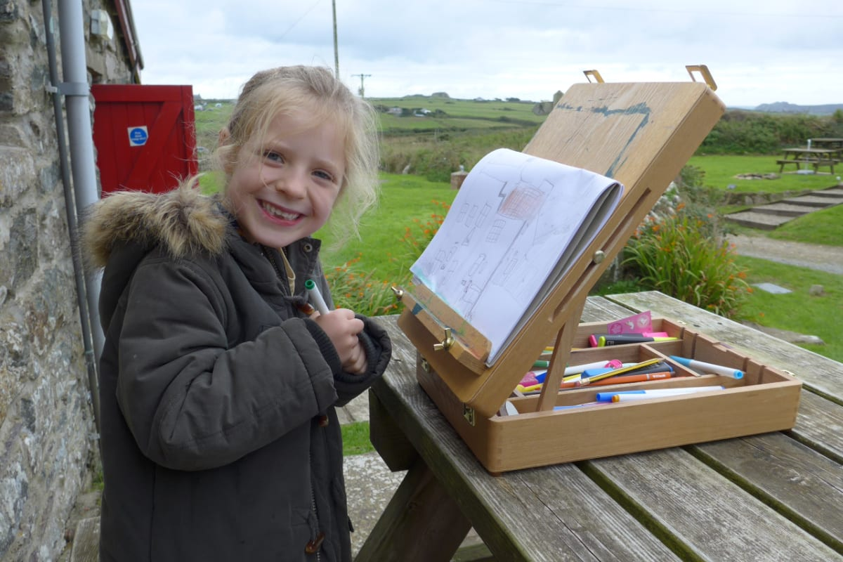 Child drawing in the countryside