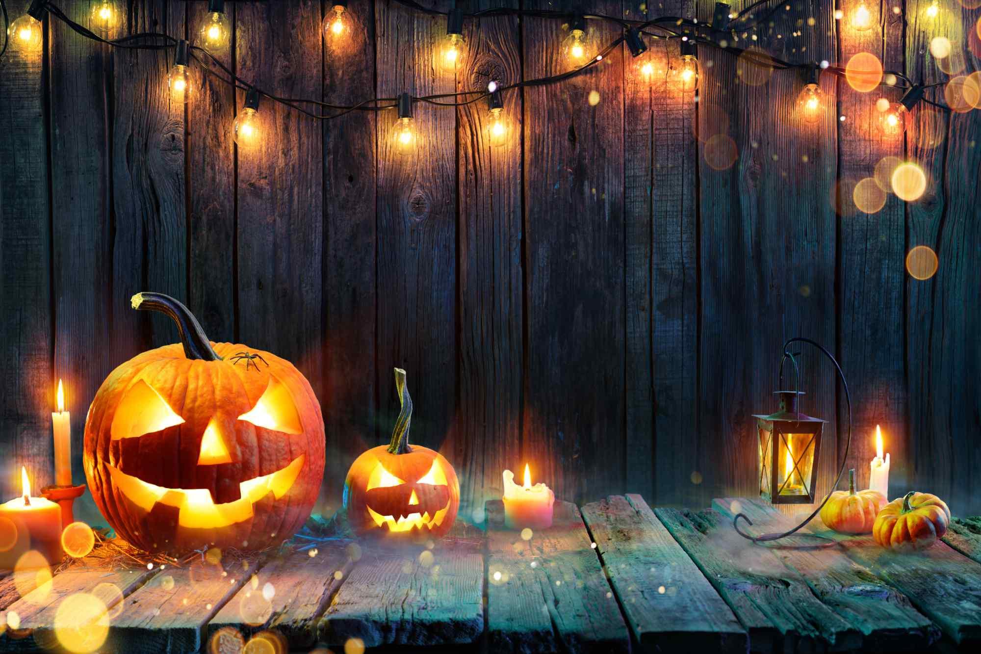 Pumpkins with fairy lights Halloween background