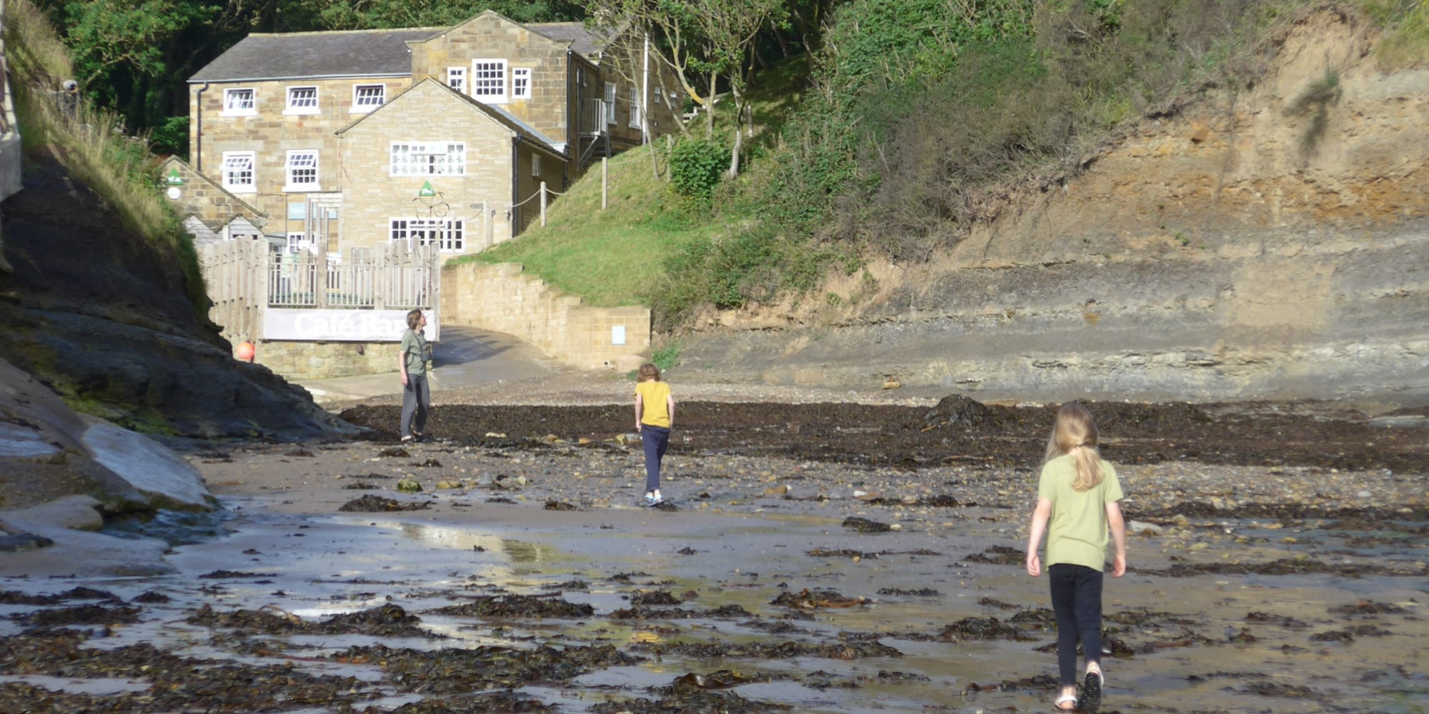 Family on the beach at YHA Boggle Hole