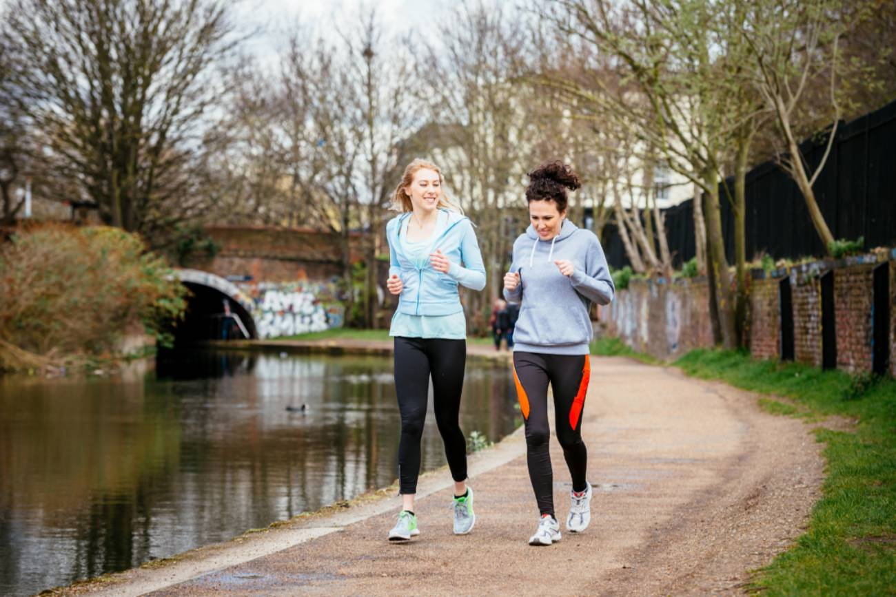 Two girls running in a park