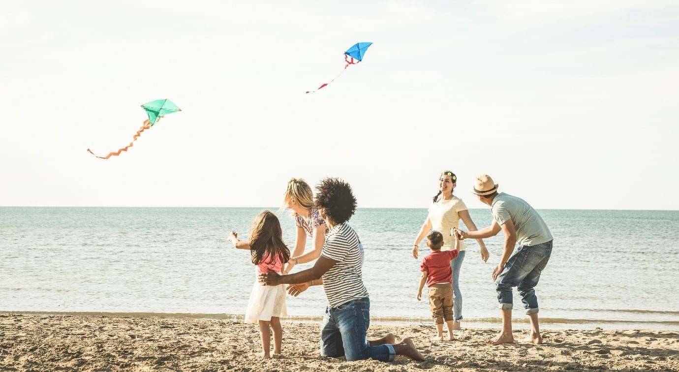 families with kite on the beach
