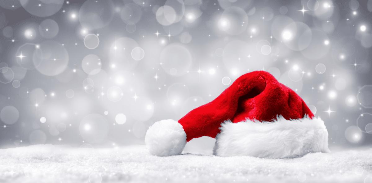 Santa hat on grey glitter background
