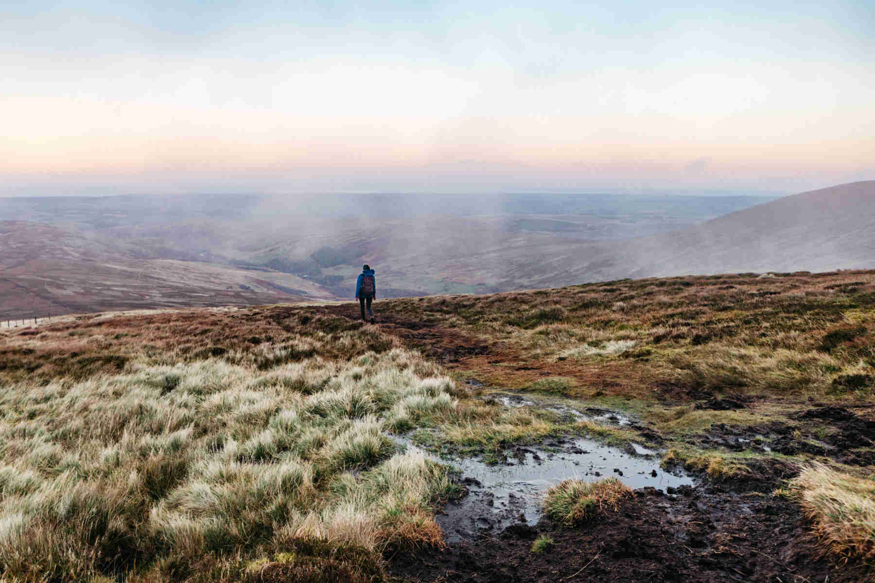 A girl walking in the northumberland national park
