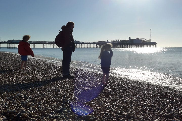 Father and two children at the seaside