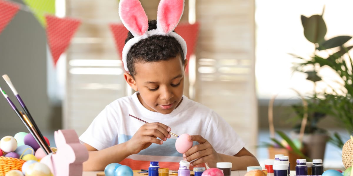 Child painting egg