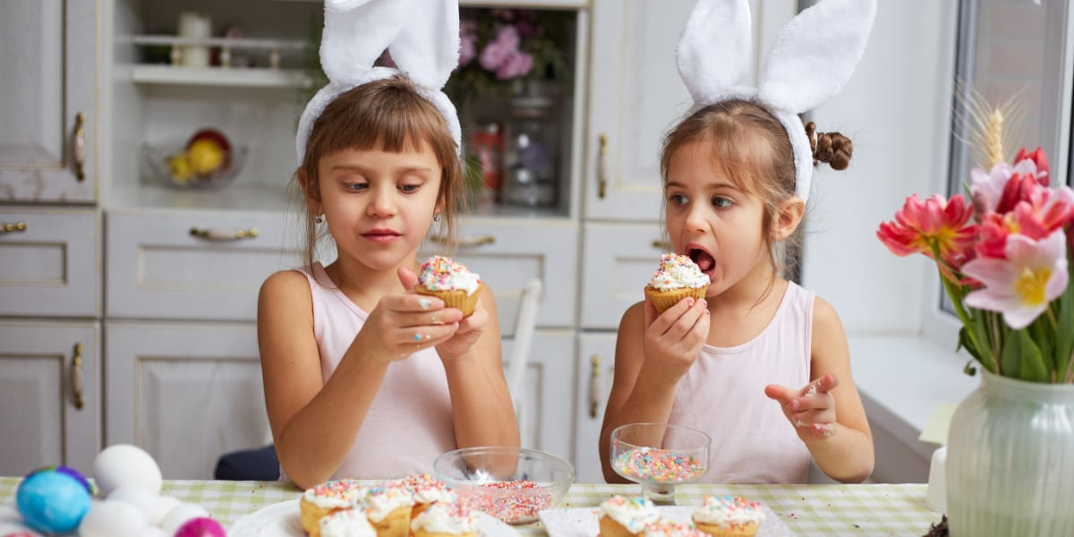 Two children eating cakes