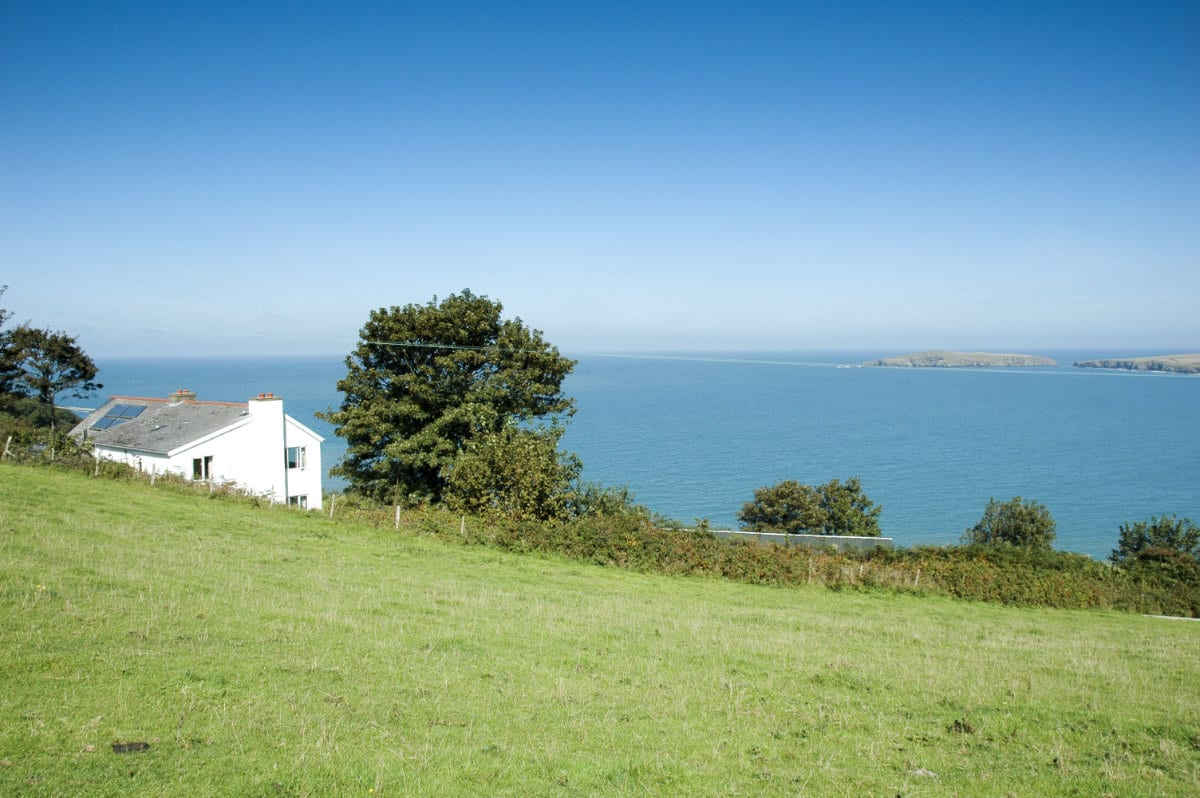 View of YHA Poppit Sands over the sea