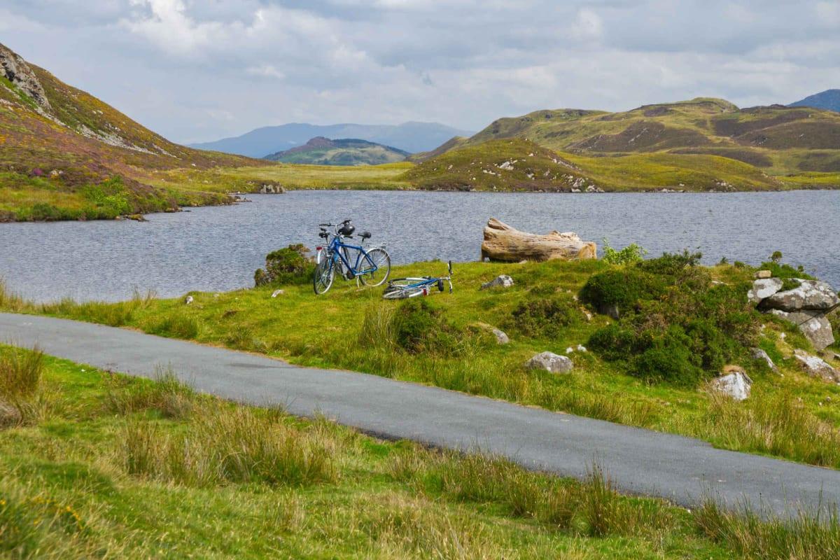 Bike parked by lake
