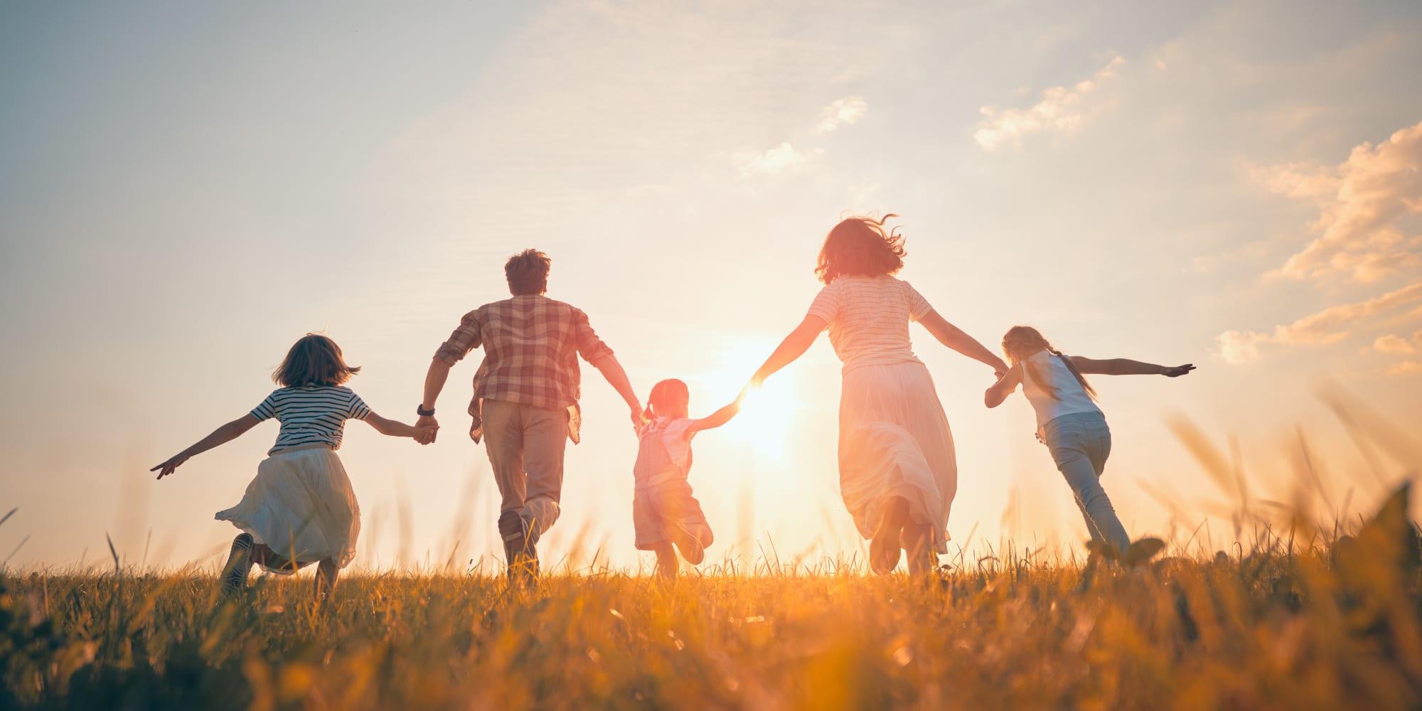 Family running in sunset