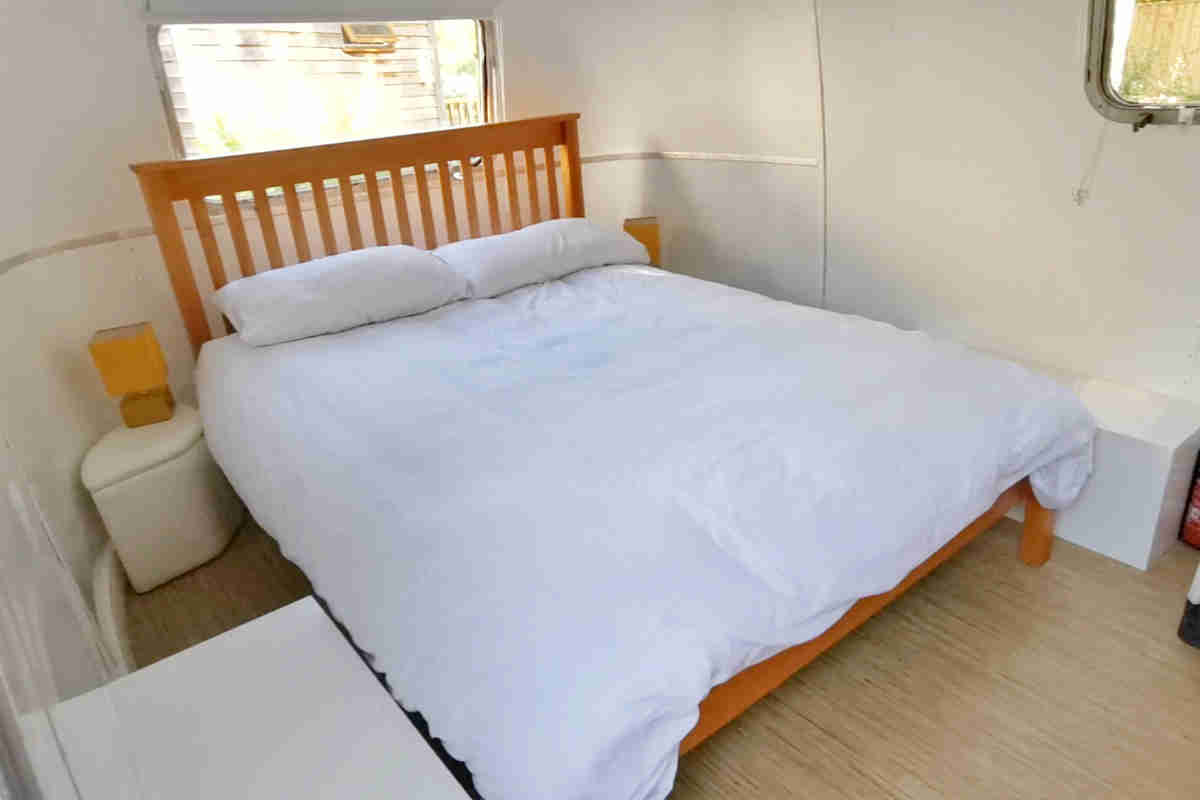 The Double Bed in the Airstream Glamping Trailer at YHA New Forest