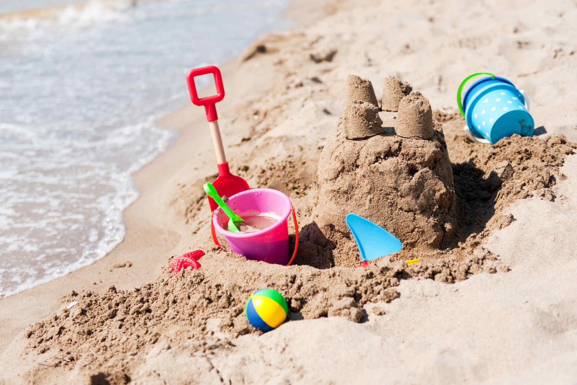 sand castle on the beach built by a child