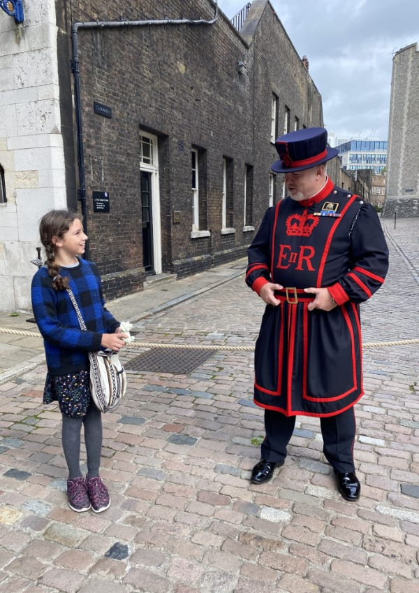 Child talking to Beefeater in London