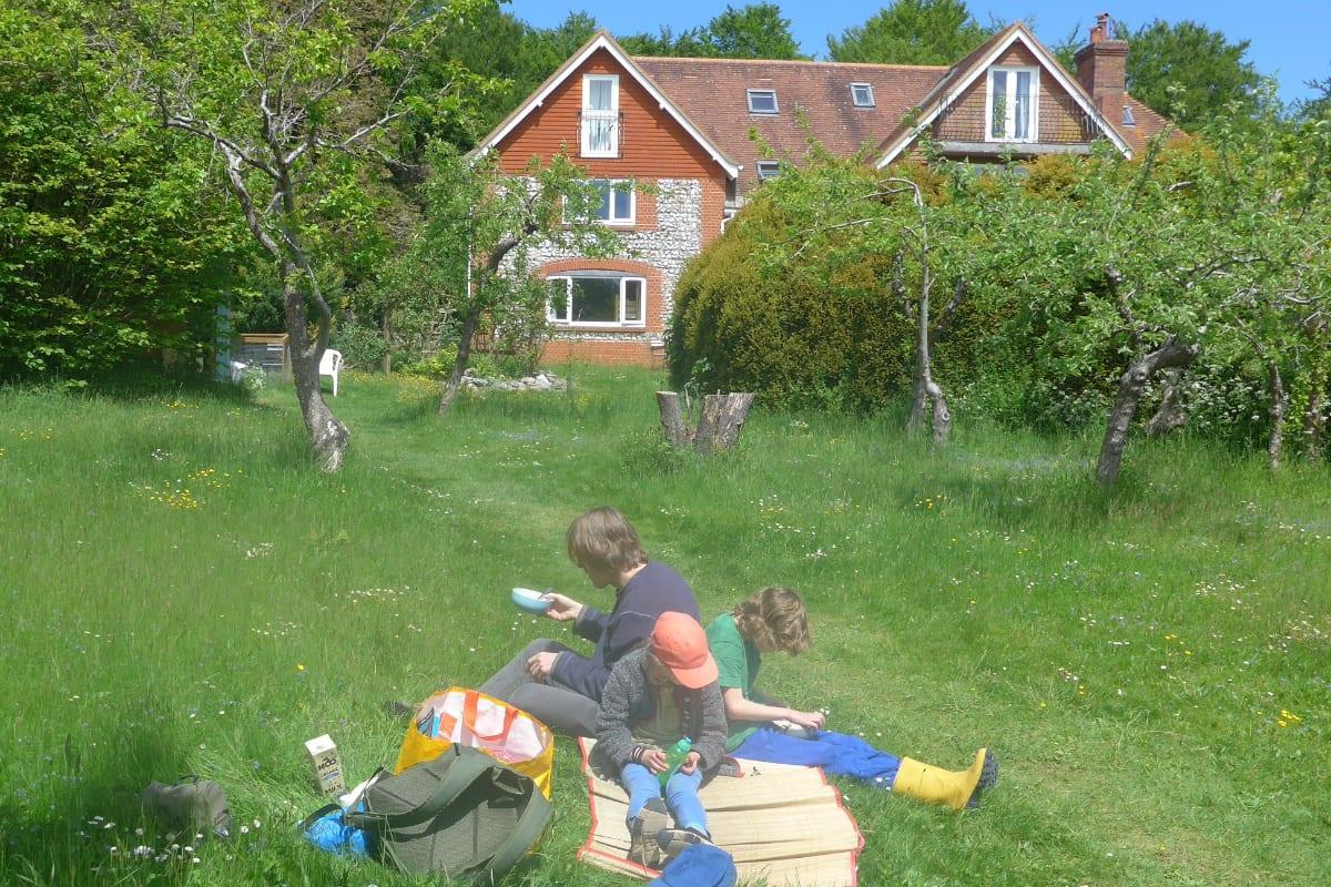 Family sitting outside YHA Cholderton