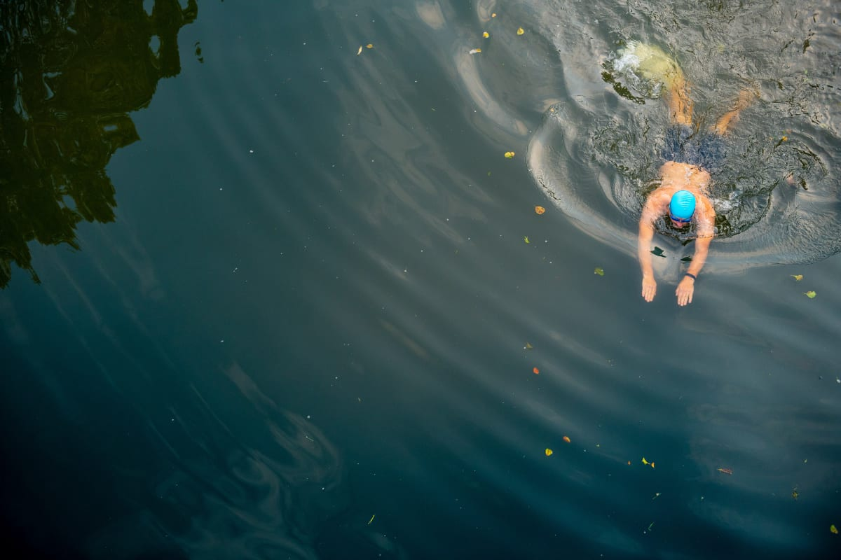 Man wild swimming in river