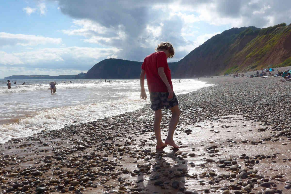 Boy paddling on the beach